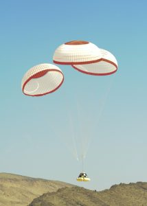 Airborne Systems. Boeing capsule drop test landing on mountain with blue sky. Space parachute & inflatable systems. Military-grade deceleration, airbag landing, aerospace recovery, personnel & cargo delivery parachute systems.