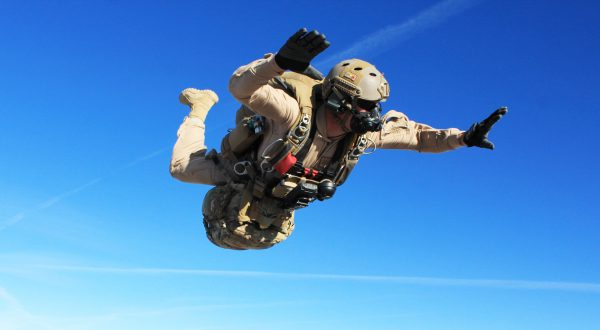Airborne Systems - Parachute Oxygen Systems for Military - SOLR™ Airborne Systems jTrax Navaid Parachute Navigation System for army and military jumpers and JPADS and GPADS cargo guided precision aerial delivery systems. Army jumper freefall SOLR mask, Navaid, blue sky.