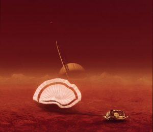 Airborne Systems. Space parachute & inflatable systems. Military-grade deceleration, airbag landing, aerospace recovery, personnel & cargo delivery parachute systems. Huygens descent control subsystem dcss. Illustration of space capsule landing on red planet with Saturn in background. huygens descent control sub system