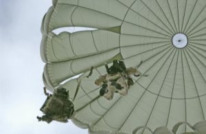 Airborne Systems MC-6 Army Troop Parachute non-steerable for military jumpers. Low opening. Carries up to 400 lbs. Minimum deployment altitude 500 ft. Canopy and jumper from below.