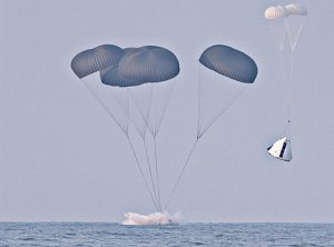 Airborne Systems. Space recovery parachutes systems. Flotation devices and landing systems. Capsule, booster, and payload recovery systems for spacecraft equipment. Max launch abort system space capsule water landing with four parachutes next to space capsule descent to land with two canopies.
