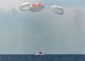 Airborne Systems. Space parachute & inflatable systems. Military-grade deceleration, airbag landing, aerospace recovery, personnel & cargo delivery parachute systems. Space capsule landing in water, three parachutes. Evolved expendable launch vehicle landing in ocean with 3 red and white canopies.