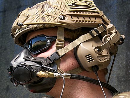 Airborne Systems Parachute Oxygen Mask for Military - SOLR™ SOLR™ military parachute oxygen mask for army jumpers. Compatible with the new SOLR™ & legacy PHAOS & PHANTOM Bailout Bottles. Soldier with oxygen mask and geared up. Side view face.