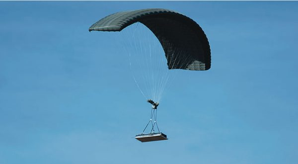Airborne Systems DragonFly Army Cargo Delivery Parachute System flying with cargo. JPADS 10K System of Choice. Eliptical canopy carries loads up to 10,000 lbs. Max altitude 24,500 ft.