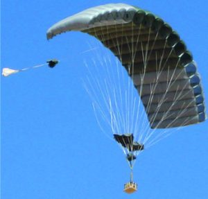 Airborne Systems FireFly Army Cargo Delivery Parachute System. JPADS 2K System of Choice. Carries unmanned loads up to 2,200 lbs. Max deployment altitude 24,500 ft. drop Deployed canopy from below with blue sky.