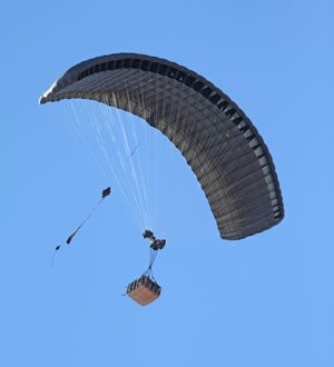 Airborne Systems FireFly Army Cargo Delivery Parachute System. JPADS 2K System of Choice. Carries unmanned loads up to 2,200 lbs. Max deployment altitude 24,500 ft. drop. Deployed canopy with cargo box from below.
