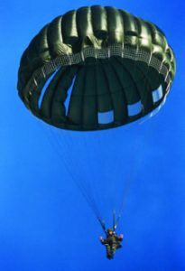 Airborne Systems MC-6 Army Troop Parachute non-steerable for military jumpers. Low opening. Carries up to 400 lbs. Minimum deployment altitude 500 ft. Lone soldier with blue sky and green chute.