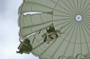 Airborne Systems. Canopy jumper and cargo from below. MC-6 Army Troop Parachute non-steerable for military jumpers. Low opening. Carries up to 400 lbs. Minimum deployment altitude 500 ft.