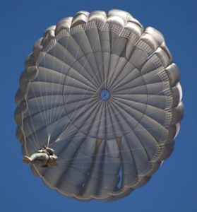 Airborne Systems. Canopy from below. MC-6 Army Troop Parachute non-steerable for military jumpers. Low opening. Carries up to 400 lbs. Minimum deployment altitude 500 ft. Military & space textile manufacturing & design. Army & space parachute canopies, aerial delivery (GPADS/JPADS). Aircraft & spacecraft deceleration systems.
