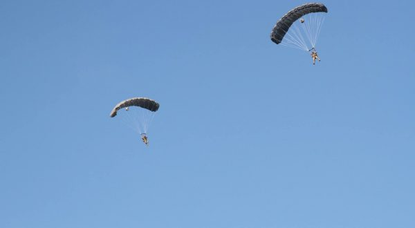 Airborne Systems - Intruder RA-1 Army Ram Air Parachute system for military special forces and beginner jumpers. Carries 450 lbs. Max deployment altitude 25,000 ft. 2 jumpers blue sky. Fort Bragg 2016.