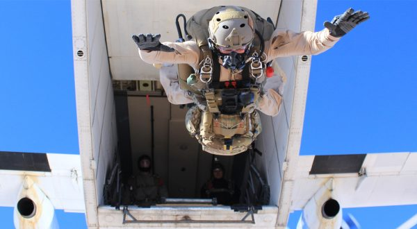 Airborne Systems Solr navaid gun freefall. Skydive Arizona. Man / soldier jumping from aircraft. The World Leader in Military Parachute Manufacturing & Training. Oxygen and navigation systems for parachutes. Air and space deceleration systems. SOLR™ military parachute oxygen mask for army jumpers. jTrax Navaid Parachute Navigation System for army and military jumpers and JPADS and GPADS cargo guided precision aerial delivery systems. When your commute is 25,000 feet... Soldier in full jump gear underneath view jumping from airplane. Aircraft in background with two soldiers.
